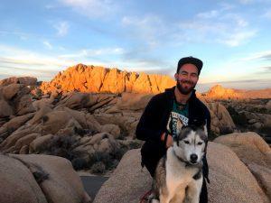 WELLL Health's Jonathan Perlin and office dog Rizzo at Joshua Tree