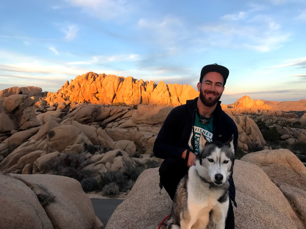 WELLL Health's Jonathan Perlin and office dog Rizzo at Joshua Tree